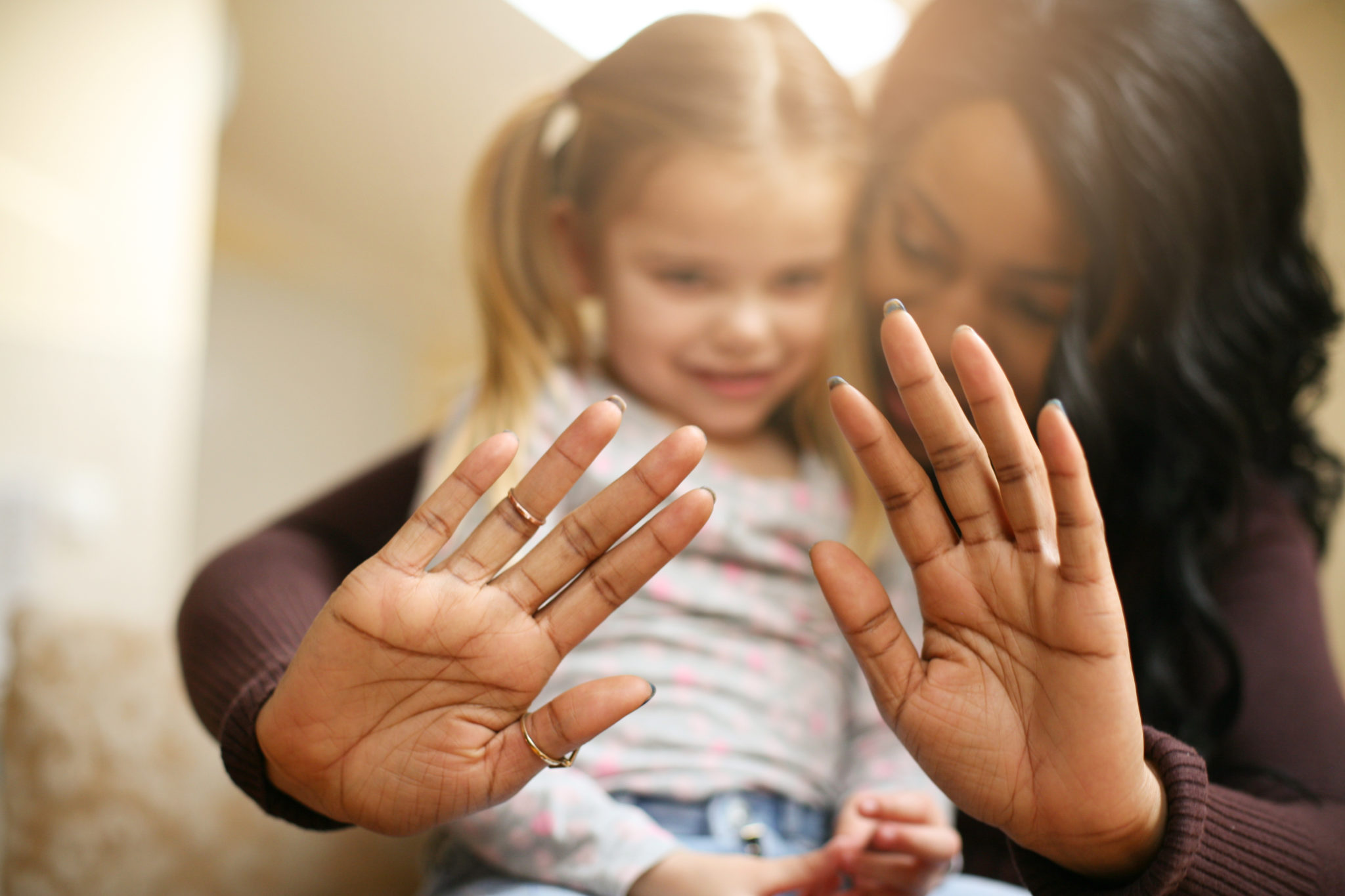 Close-up. African American woman with child. Focus on hands.